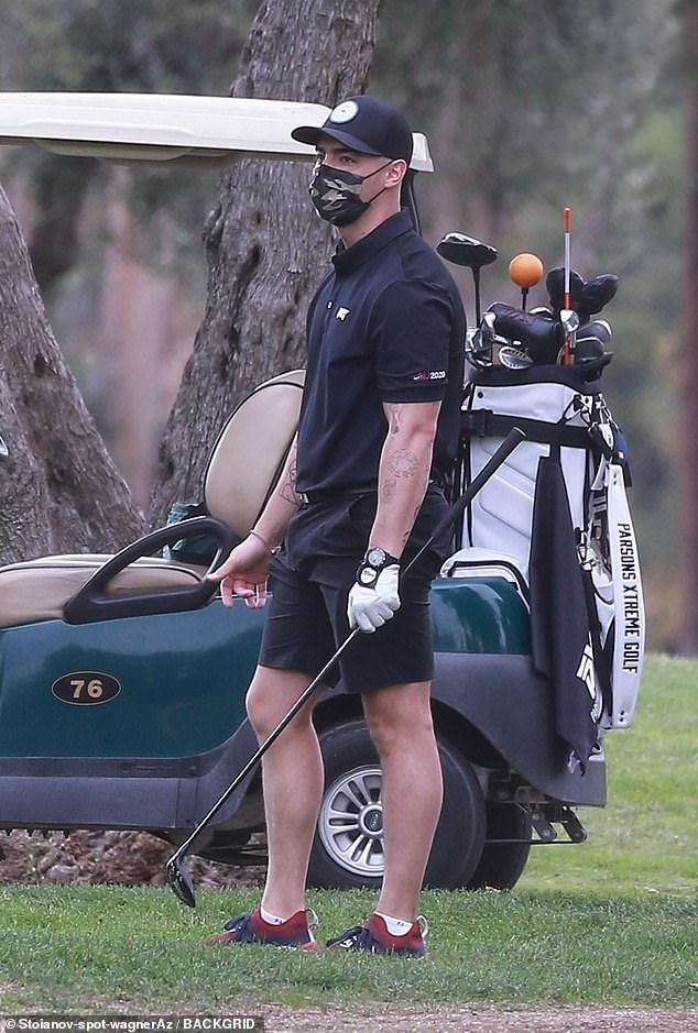 Me time: Joe Jonas took a break from parenting duties on Thursday as he enjoyed a round of golf in Los Angeles, California