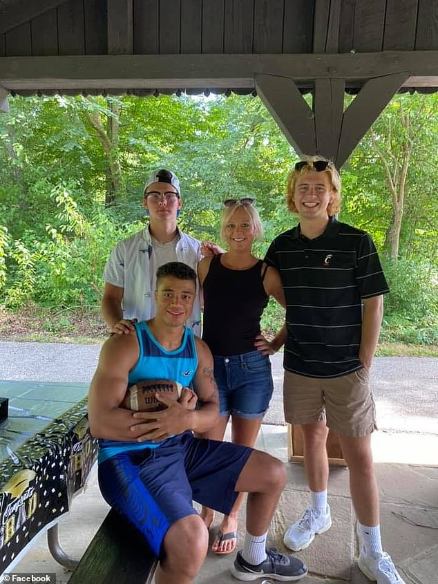The divorced mother-of-three (pictured with her sons) was reported missing by her ex-husband on Thanksgiving Day