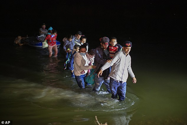 The federal government has been dealing with an influx of migrants who have been crossing the border in recent weeks. The image above shows migrant families from Central America wade through shallow waters after being delivered by smugglers on small inflatable rafts in Roma, Texas last Wednesday