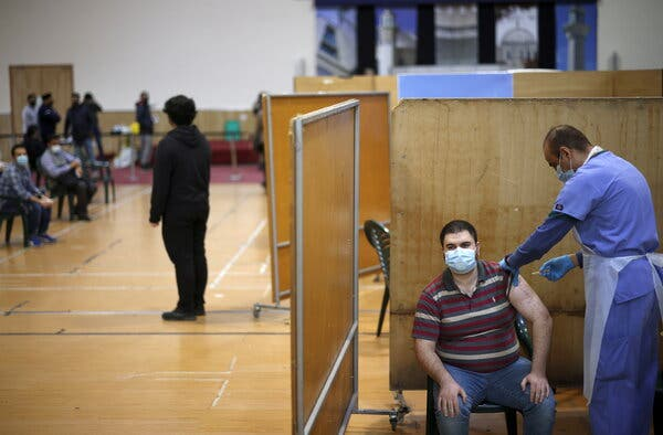 A vaccination center at a mosque in London on Sunday. Britain has administered more than 30 million vaccine doses.