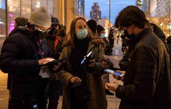 """A guest showed her """"Excelsior Pass,"""" with proof of vaccination, on a phone outside the The Shed, a performing and visual arts venue in New York."""
