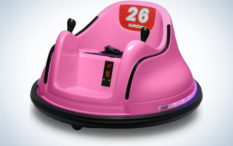 Kidzone pink electric rider toy with black safety belt and red buttons in front of it.