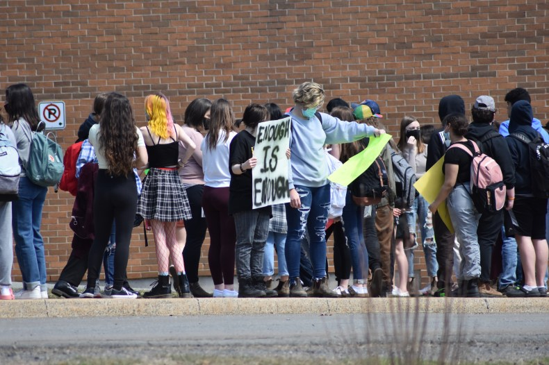 Students walked out of West Kings District High School in Auburn on Thursday afternoon in support of a female student who says she was suspended after bringing to light a shirt a male student was wearing which read