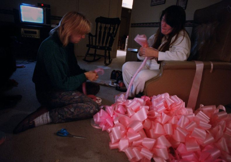 Barbara Dyess and Tammy Zimmerman make pink bows at 3 a.m. on Jan. 18, 1996 for Amber Hagerman as they await word on the identity of a child's body which had been found earlier that evening. Zimmerman, who was crying as she tied the bows, said they were  going to continue despite the outcome of the news.