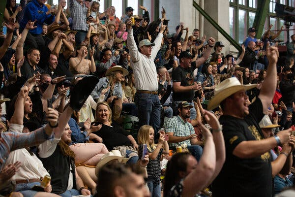 Watching the Stockyards Championship Rodeo in Fort Worth, Texas, where mask mandates have been lifted.
