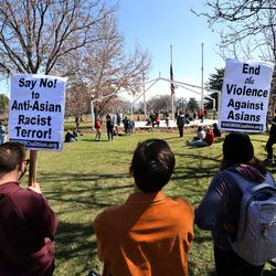 People protest against anti-Asian racist violence, violence against women and white supremacy at the International Peace Gardens in Salt Lake City on Saturday, March 27, 2021.