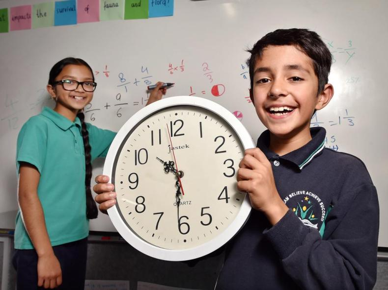 Students Ria (left) and Arnav (right) at Glen Waverley Primary School in Melbourne. A simpler syllabus to start next year will mean students would be taught to tell the time until Year 2. Picture: Nicki Connolly