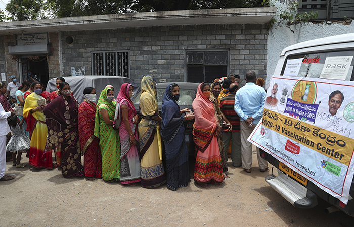 People stand in to register for Covid-19 vaccines during a special vaccination drive in Hyderabad, India.