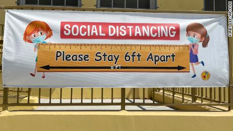 A social distancing sign hangs at Morris K. Hamasaki Elementary School in Los Angeles on July 1.