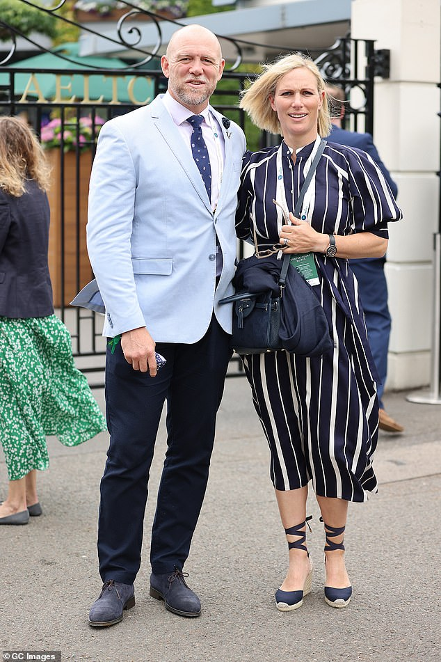 Mike (pictured, with Zara) looked dapper in a light blue suit jacket, crisp white shirt and patterned navy tie, which he paired with some smart suede shoes