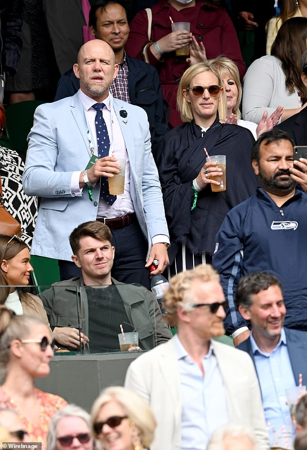 Zara and Mike Tindall could be seen sipping on what appeared to be a glass of Pimm's as they enjoyed some light refreshments this afternoon