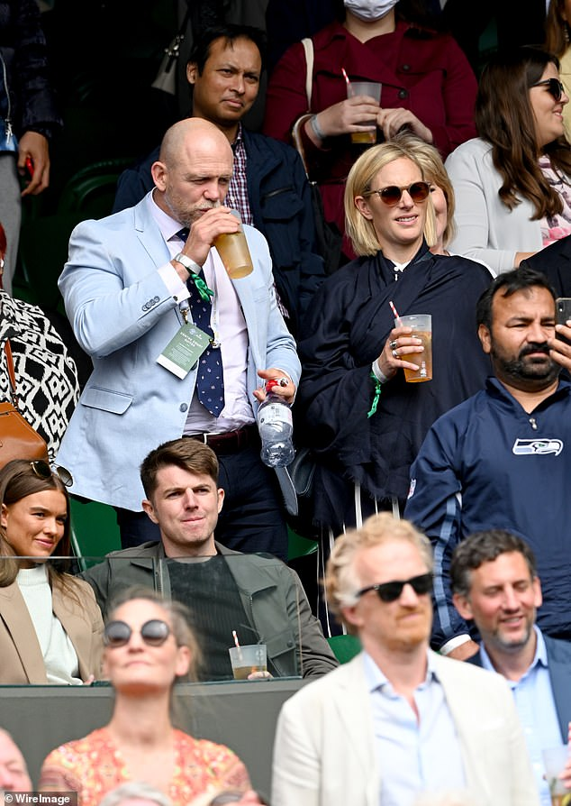 Mike Tindall was photographed taking a sip of his drink and Zara watched on at day nine of Wimbledon