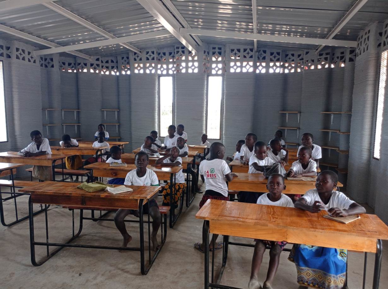 these students are sitting inside their new 3D-printed school, built to house up to 50 pupils, in Salima, Malawi