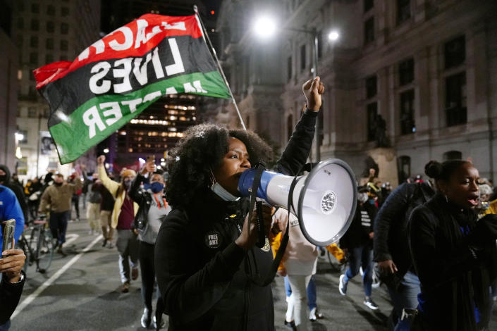 A Black Lives Matter protester marches in Philadelphia last November to urge that all votes be counted. (Matt Slocum/AP)