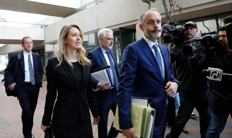 Former Theranos CEO Elizabeth Holmes and lawyer Kevin Downey leave a federal court after a status hearing on July 17, 2019 in San Jose, California.