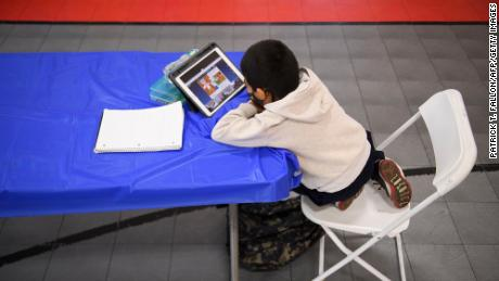 A child attends an online class at the Crenshaw Family YMCA on February 17, 2021, in Los Angeles.