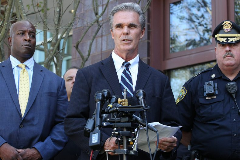 Worcester County District Attorney Joseph D. Early Jr., center, holds a press conference in 2018. (Suzanne Kreiter/The Boston Globe via Getty Images)