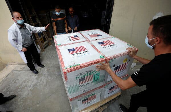 Palestinians receive a shipment of coronavirus vaccine donated by the U.S in the Israeli-occupied West Bank on Tuesday.