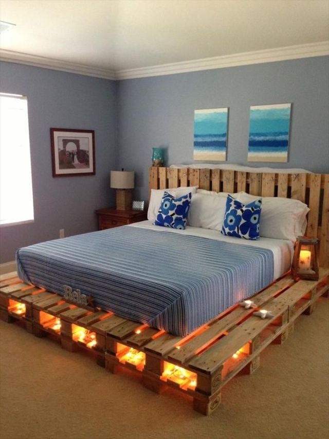 bedroom-idea-with-blue-white-bed-on-DIY-pallet-wood-platform-bed-and-wood-bedside-table