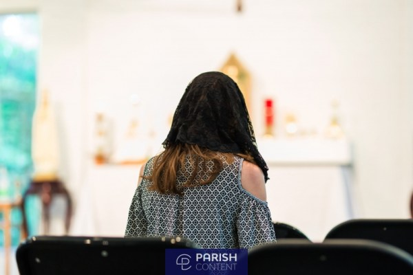Woman Praying During Mass