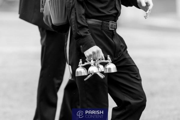 Seminarian Carrying Altar Bells