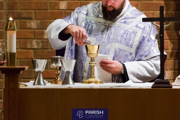 Priest Preparing Communion