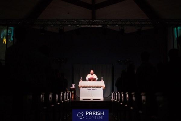 Priest Praying Communion