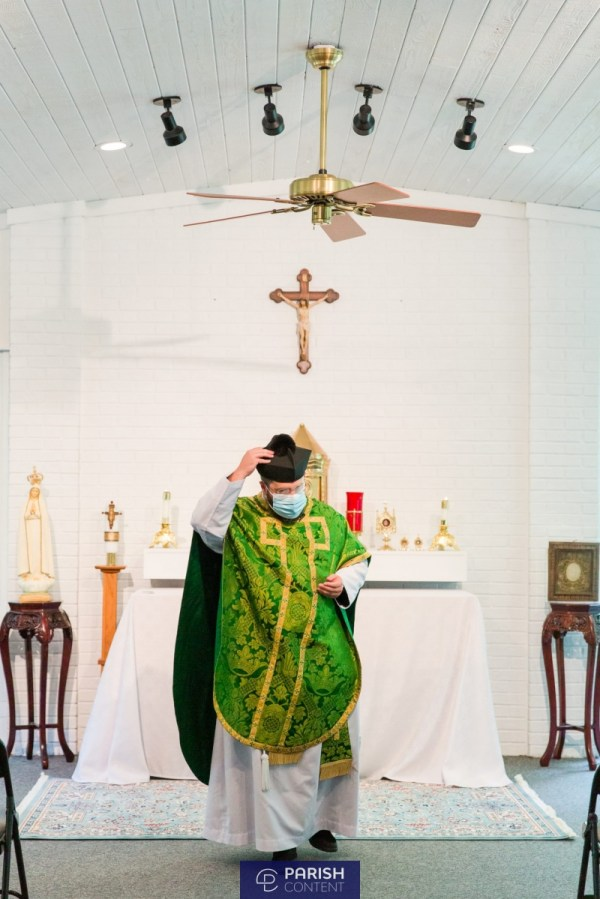 Priest Processing Out Of Mass