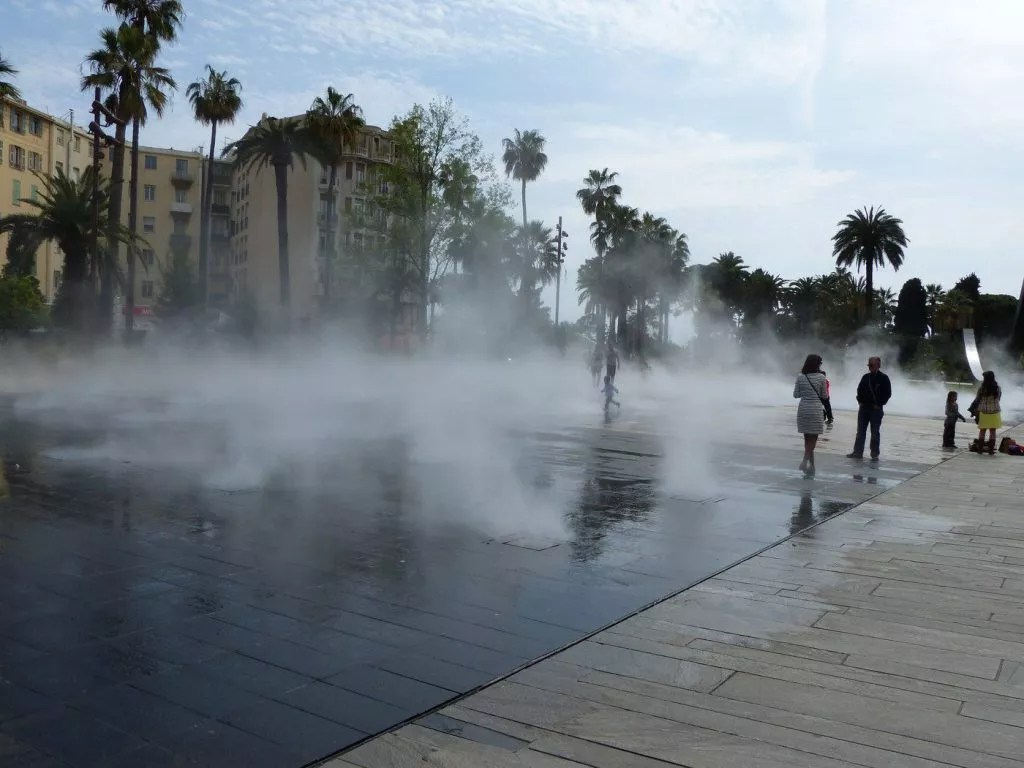 Playing in the mist near Place Masséna, Nice