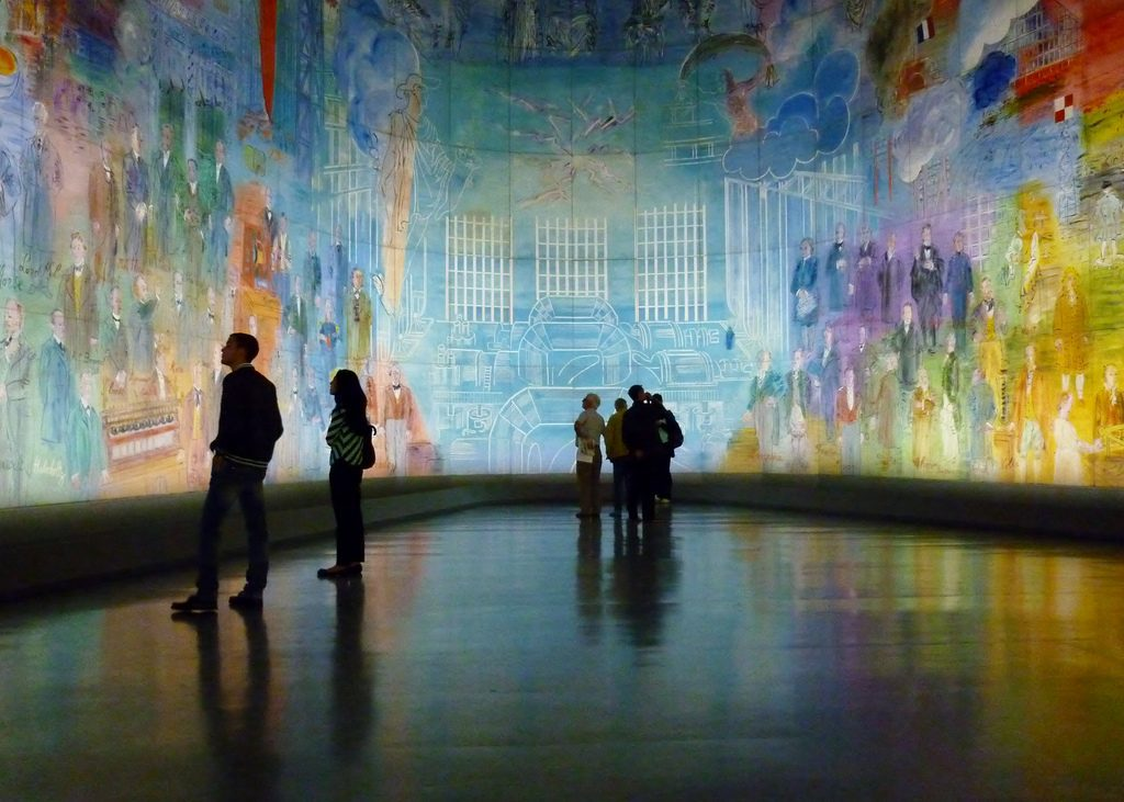 Visitors take in an enormous installation at Paris' Modern Art Museum.