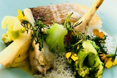 A catch of the day main course at Coretta in Paris: delicate sea bream with peppered artichokes, fennel, broccoli and decorative edible flowers.