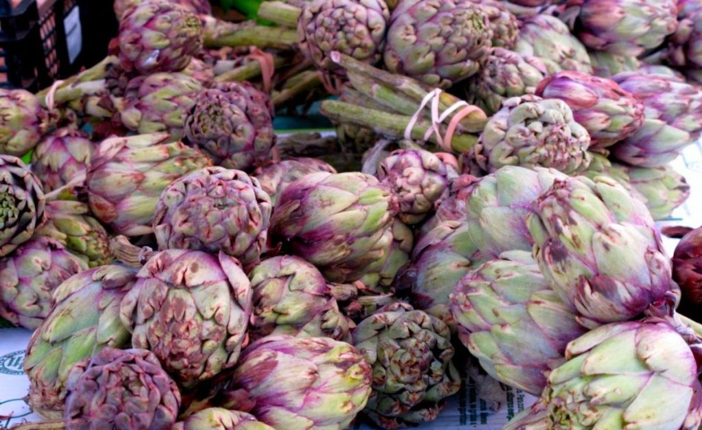 Beautiful purple artichokes at the Marche d'Aligre: who said produce couldn't be poetry in its own right? Seasonal and fresh products are guaranteed at most Parisian farmers' markets. Image: Courtney Traub