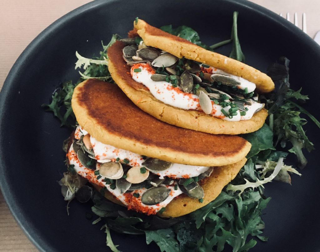 Rice and chickpea galettes/pancakes with cashew cream, pumpkin seeds, arugula, herbs and spices at Le Potager de Charlotte. Image: Courtney Traub/All rights reserved