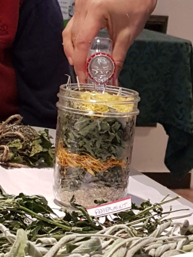 We poured the vodka over the herbs to cover them and sealed the jar.