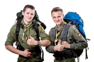 Two young scout boys with sleeping bag and backpack