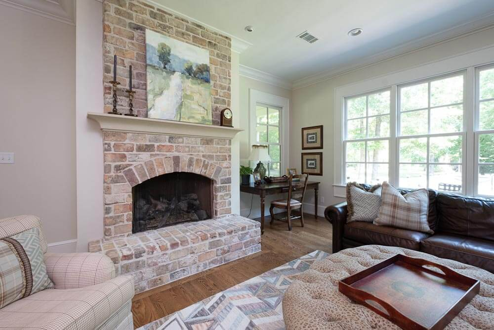 Light red colored, exposed brick fireplace