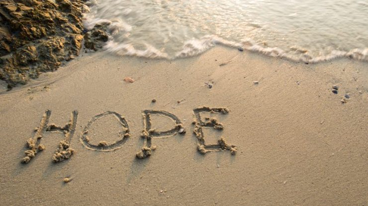 hope, the word, written out on a beach