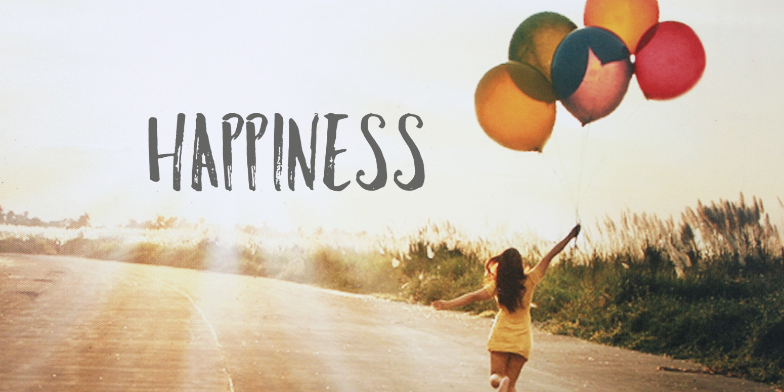 happiness - girl holding balloons