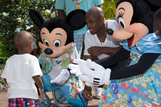NFL Player Adrian Peterson of the Minnesota Vikings with Mickey and Minnie Mouse at Aulani, a Disney Resort & Spa for the Aulani Pro Bowl Reception