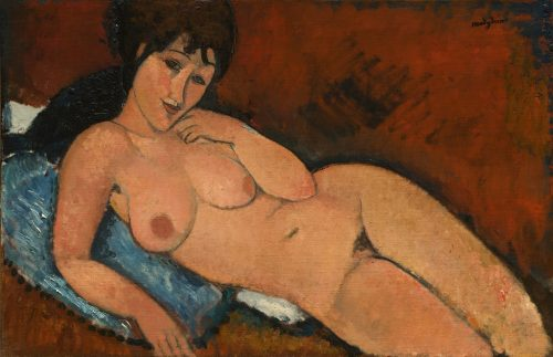 nude on a blue cushion