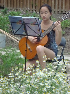 This young musician entertained us as we weeded!