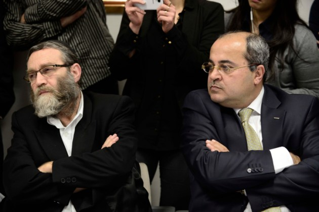 Ahmad Tibi, Deputy Speaker of the Knesset, sits next to Ultra Orthadox MK Moshe Gafni at a meeting of the Opposition