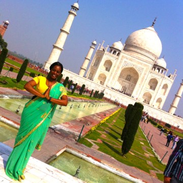 Michelle poses pretty in front of the Taj Mahal in India.