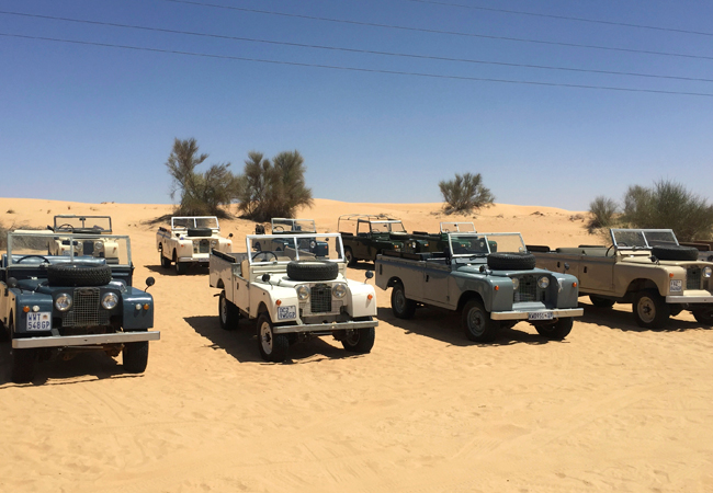 A fleet of vintage 1960's Land Rovers to explore the desert