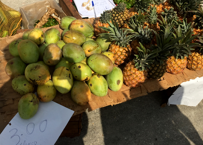 Mangoes and pineapples for sale on the streets of Centro