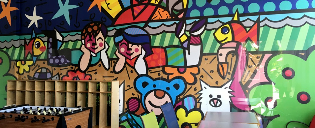 A wall mural by Romero Britto in the children's activity center