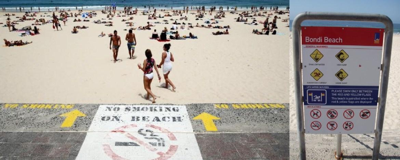 Sinais com proibição de fumar na praia de Bondi (Sidney, Austrália)