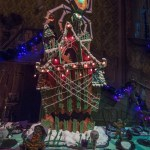 "HAUNTED MANSION HOLIDAY GINGERBREAD HOUSE (Anaheim, Calif.)– Now through Jan. 6, 2019, Haunted Mansion Holiday brings the frightfully fun cheer of ""Tim Burton's Nightmare Before Christmas"" to the Disneyland Resort. This year, the gingerbread display features a giant five foot spider with eerie glowing eyes, attempting to pry the edible mansion from its foundation. This year's gingerbread creation is made up of 90 pounds of gingerbread, 30 pounds of confectioner's sugar, 10 pounds of white chocolate and 45 pounds of fondant."