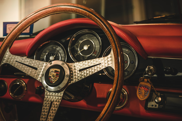Classic Porsche dashboard with red detailing