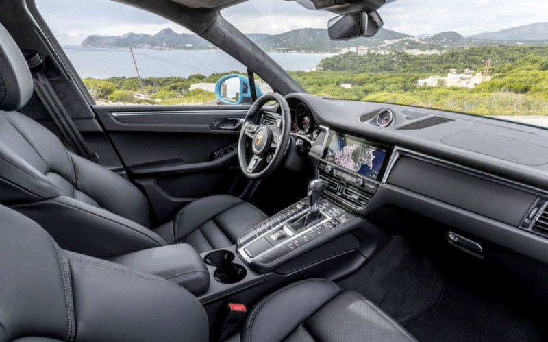 Porsche SUV interior with view of countryside